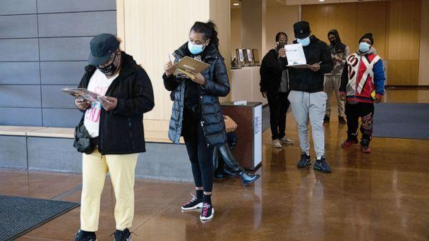 PHOTO: Voters wearing protective masks wait in line to cast ballots at a polling location for the 2020 Presidential election in Detroit, Nov. 3, 2020. (Bloomberg via Getty Images, FILE)