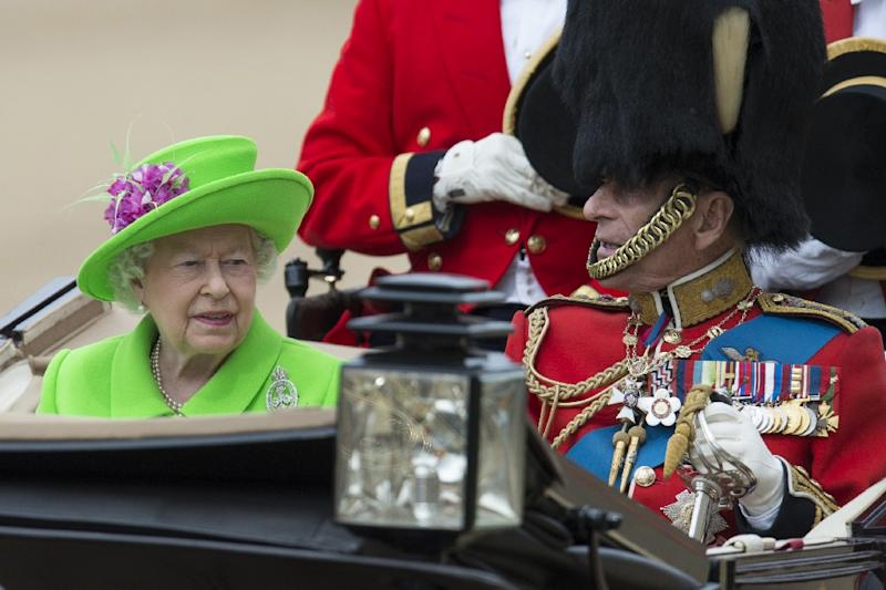 Britain's Queen Elizabeth II and Prince Philip, Duke of Edinburgh prepare to leave Horse Guards Parade in a horse-drawn carriage following the Queen's Birthday Parade, 'Trooping the Colour', in London on June 11, 2016 (AFP Photo/Oli Scarff)