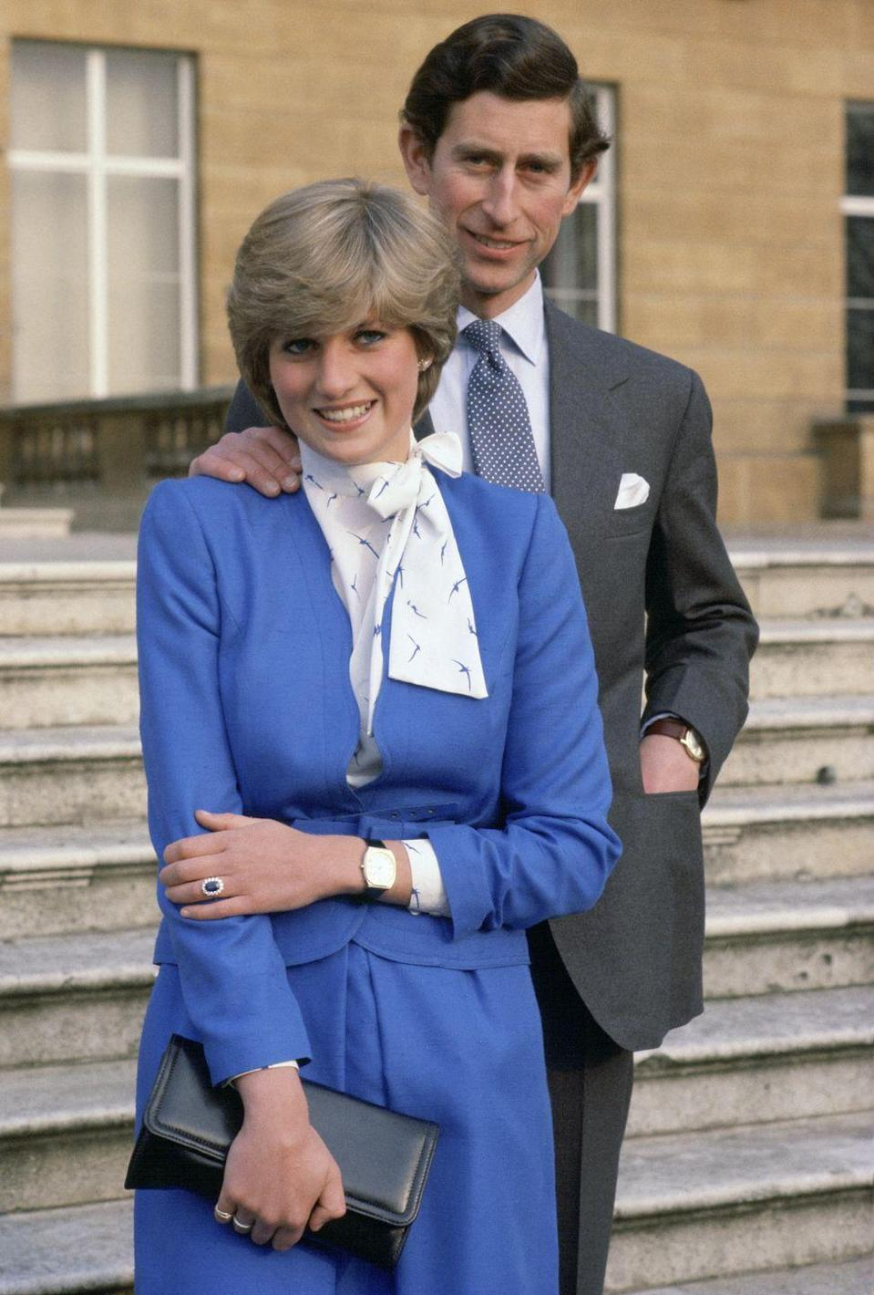 <p>Charles chose to wear a grey suit, blue and white polka dot tie, light blue button-down, and a white handkerchief. </p>
