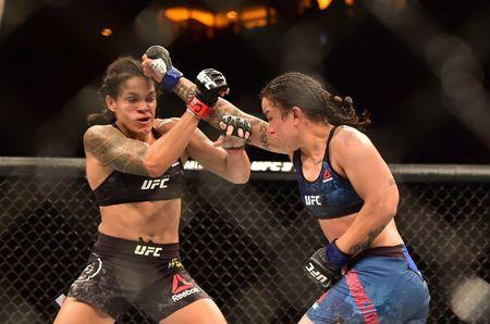 May 12, 2018; Rio de Janeiro, RJ, Brazil; Amanda Nunes (red) fights Raquel Pennington (blue)​​ during UFC 224 at Jeunesse Arena. Mandatory Credit: Jason Silva-USA TODAY Sports