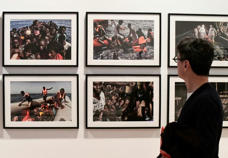 A Milan exhibit showing pictures from a migrant rescue operation taken by AFP photographer Aris Messinis off the Libyan coast