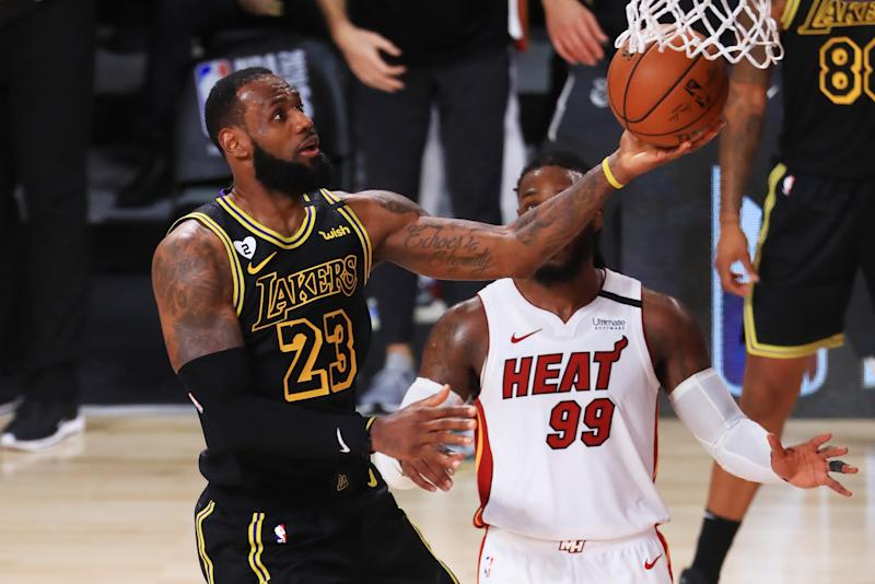 LeBron James #23 of the Los Angeles Lakers drives to the basket during the fourth quarter against the Miami Heat in Game Five of the 2020 NBA Finals at AdventHealth Arena at the ESPN Wide World Of Sports Complex
