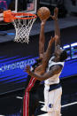 Miami Heat forward Trevor Ariza, left, goes up for a shot against Dallas Mavericks forward Dorian Finney-Smith during the first half of an NBA basketball game, Tuesday, May 4, 2021, in Miami. (AP Photo/Wilfredo Lee)