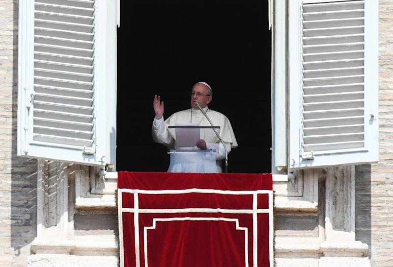 Pope Francis waves to pilgrims gathered in St. Peter's square during his Sunday Angelus prayer on August 20, 2017 at the Vatican