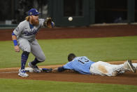 Tampa Bay Rays' Manuel Margot is safe at third past Los Angeles Dodgers third baseman Justin Turner after a Los Angeles Dodgers fielding error by Chris Taylor during the fourth inning in Game 5 of the baseball World Series Sunday, Oct. 25, 2020, in Arlington, Texas. (AP Photo/Eric Gay)