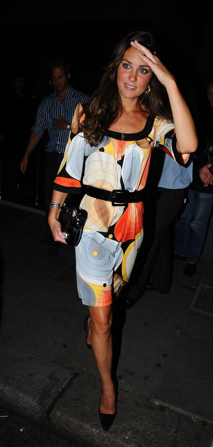 <p>Wearing a belted dress while out in London.</p>