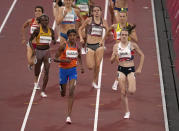 Sifan Hassan, of Netherlands races ahead of Laura Muir, of Britain to win a women's 1,500-meter semifinal at the 2020 Summer Olympics, Wednesday, Aug. 4, 2021, in Tokyo, Japan. (AP Photo/Charlie Riedel)