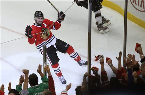 Chicago Blackhawks center Patrick Sharp (10) reacts after scoring a goal against the Los Angeles Kings during the second period in Game 1 of the NHL hockey Stanley Cup Western Conference finals Saturday, June 1, 2013, in Chicago. (AP Photo/Charles Rex Arbogast)