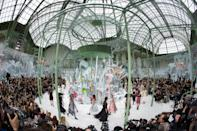 <p>For the SS15 runway extravaganza, Chanel took arts and crafts to a whole new level with intricate paper flowers taking over the show space.<em>[Photo: Getty]</em> </p>
