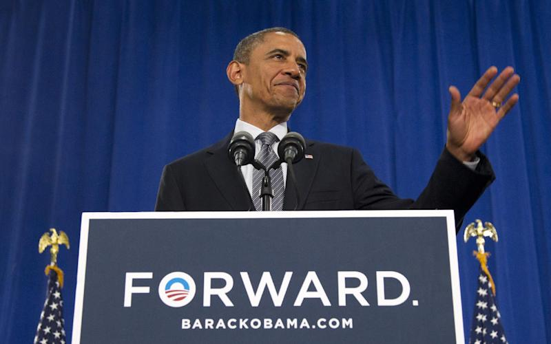 President Barack Obama waves prior to speaking at Cuyahoga Community College in Cleveland, Thursday, June 14, 2012. (AP Photo/Carolyn Kaster)