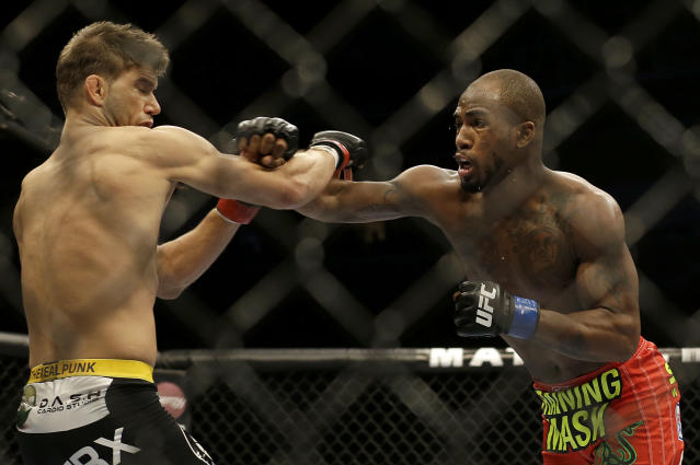 Bobby Green punches Josh Thomson during the first round of a lightweight mixed martial arts bout at a UFC event in San Jose, Calif., Saturday, July 26, 2014. Green won by split decision. (AP Photo/Jeff Chiu)