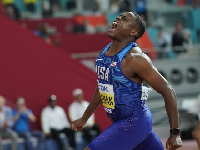 Christian Coleman, of the United States, celebrates winning the gold medal in men's 100 meter final at the World Athletics Championships in Doha, Qatar, Saturday, Sept. 28, 2019. (AP Photo/David J. Phillip)