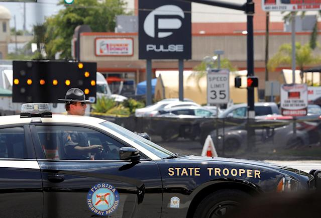 <p>A Florida State Trooper blocks the road leading to the site of the shooting at the Pulse gay night club in Orlando, Florida, June 13, 2016. (REUTERS/Jim Young) </p>