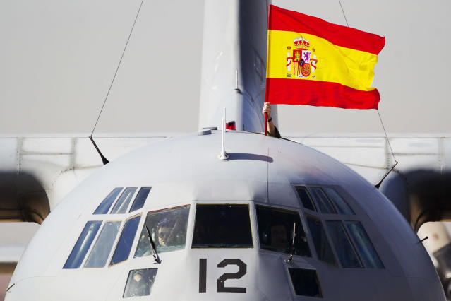 A Spanish flag is waved from a plane carrying some of the 17 tons of silver and gold coins scooped up from a Spanish warship, Nuestra Senora de las Mercedes, that sank during a 1804 gunbattle, after its arrival at the Torrejon De Ardoz military airbase, near Madrid, on Saturday Feb. 25, 2012. Two Spanish military C-130 transport planes landed out from Tampa's MacDill Air Force Base with the 594,000 coins and other artifacts retrieved after a five-year legal wrangle with Odyssey Marine Exploration company who had found the shipwreck off the Portuguese coast and flew the treasure back to the U.S. via Gibraltar in May 2007.(AP Photo/Daniel Ochoa de Olza)