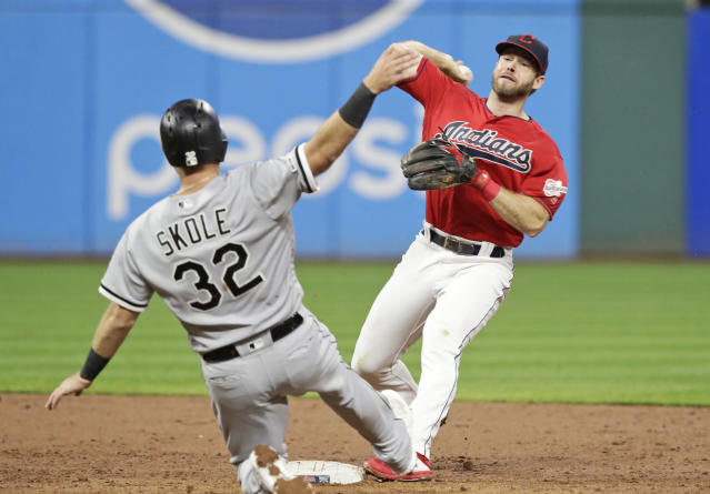 Cleveland Indians' Mike Freeman, right, throws to first base after getting Chicago White Sox's Matt Skole (32) out at second base in the fourth inning in a baseball game Monday, Sept. 2, 2019, in Cleveland. (AP Photo/Tony Dejak)
