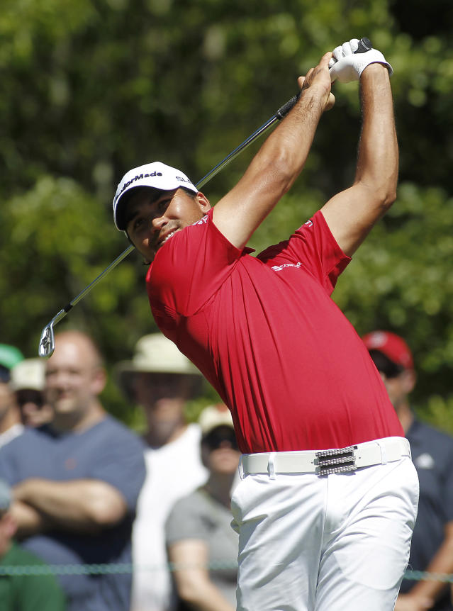 Jason Day, from Australia, tees off on the first hole during the second round of the Deutsche Bank Championship golf tournament in Norton, Mass., Saturday, Aug. 30, 2014. (AP Photo/Stew Milne)