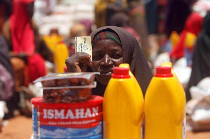 FILE PHOTO: An internally displaced Somali woman receives relief food at a distribution centre organized by a Qatar charity after fleeing from drought stricken regions in Baidoa, west of Somalia's capital Mogadishu