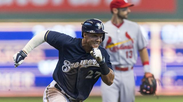 Milwaukee Brewers' Carlos Gomez rounds third on his way home for the first run of the game against St. Louis Cardinals' during the first inning of a baseball game Sunday, July 13, 2014, in Milwaukee. (AP Photo/Tom Lynn)