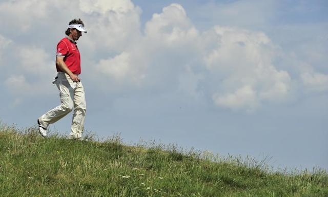 German golfer Bernard Langer walks off the 10th green, on the second day of the 140th British Open Golf championship at Royal St George's in Sandwich, Kent, south east England, on July 15, 2011 (AFP Photo/Glyn Kirk)