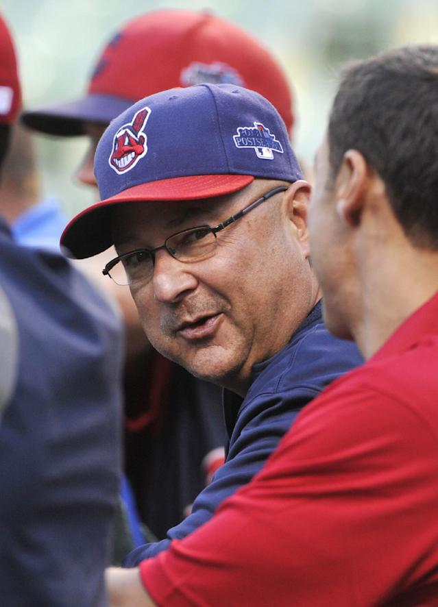 Cleveland Indians manager Terry Francona talks with general manager Chris Antonetti during batting practice before the AL wild-card baseball game against the Tampa Bay Rays on Wednesday, Oct. 2, 2013, in Cleveland. (AP Photo/Phil Long)