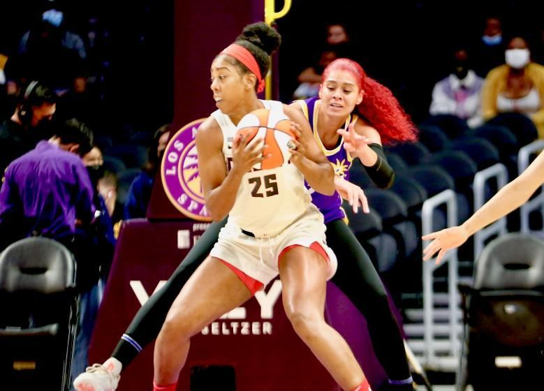 Sparks' Amanda Zahui B reaches to try to steal the ball from Atlanta Dream forward Monique Billings.