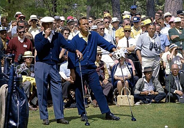 Two icons of style, Ben Hogan and Arnold Palmer, smoke as they wait to play their tee shots on the second hole during the 1966 Masters.