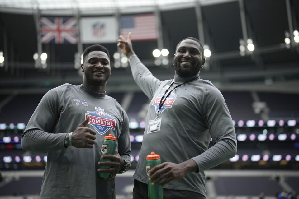 Up Rise Academy's offensive linemen Haggai Chison Noubuis, left, and Mbaeteka Chigbo Roy, both from Nigeria, pose for photographs after taking part in the NFL International Combine at the Tottenham Hotspur Stadium in London, Tuesday, Oct. 12, 2021. International athletes on Tuesday took part in a series of tests in front of NFL evaluators for a potential position in the NFL's International Player Pathway programme. (AP Photo/Matt Dunham)