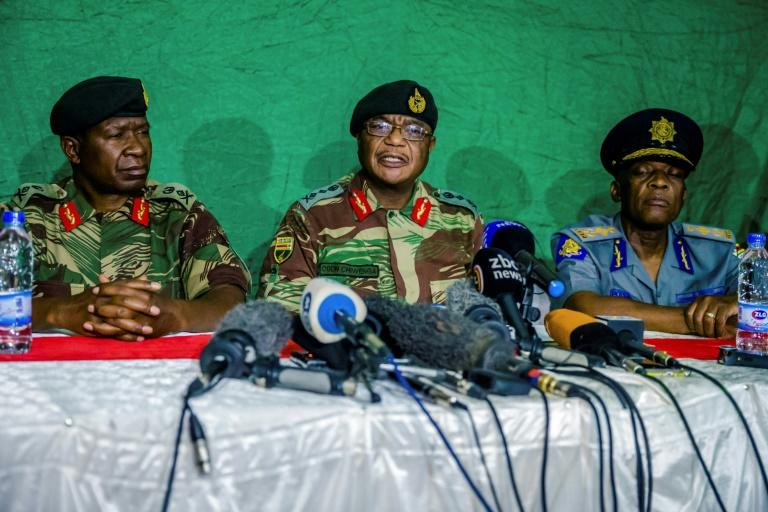 Zimbabwe's army chief Constantino Chiwenga (C) told reporters that progress had been made in talks towards an apparent exit deal for Mugabe, the world's oldest head of state