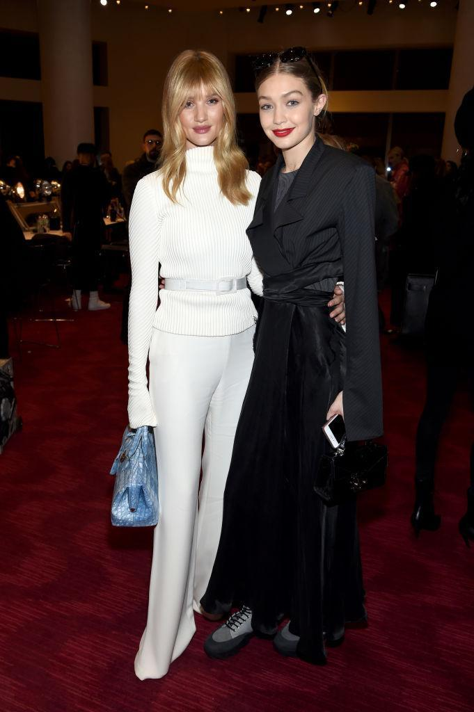 <p>Gigi Hadid joins Rosie Huntington-Whiteley for a photo opportunity. <em>[Photo: Getty]</em> </p>
