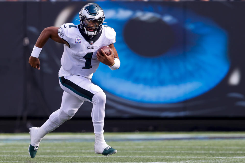 Philadelphia Eagles quarterback Jalen Hurts runs against the Carolina Panthers during the second half of an NFL football game Sunday, Oct. 10, 2021, in Charlotte, N.C. (AP Photo/Nell Redmond)