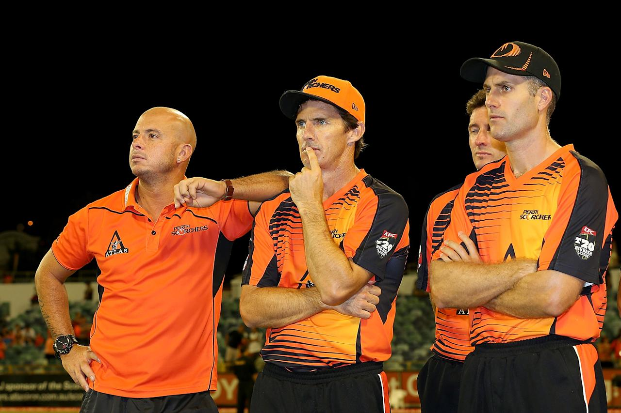 PERTH, AUSTRALIA - JANUARY 19: Herschelle Gibbs, Brad Hogg and Simon Katich of the Scorchers look on after being defeated during the Big Bash League final match between the Perth Scorchers and the Brisbane Heat at the WACA on January 19, 2013 in Perth, Australia.  (Photo by Paul Kane/Getty Images)