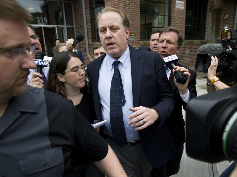 Former Boston Red Sox pitcher Curt Schilling, center, is followed by members of the media as he departs the Rhode Island Economic Development Corporation headquarters, in Providence, R.I., Wednesday, May 16, 2012. Schilling briefed Rhode Island Gov. Lincoln Chafee and economic development officials Wednesday during a closed-door meeting that could determine the fate of his video game company. (AP Photo/Steven Senne)