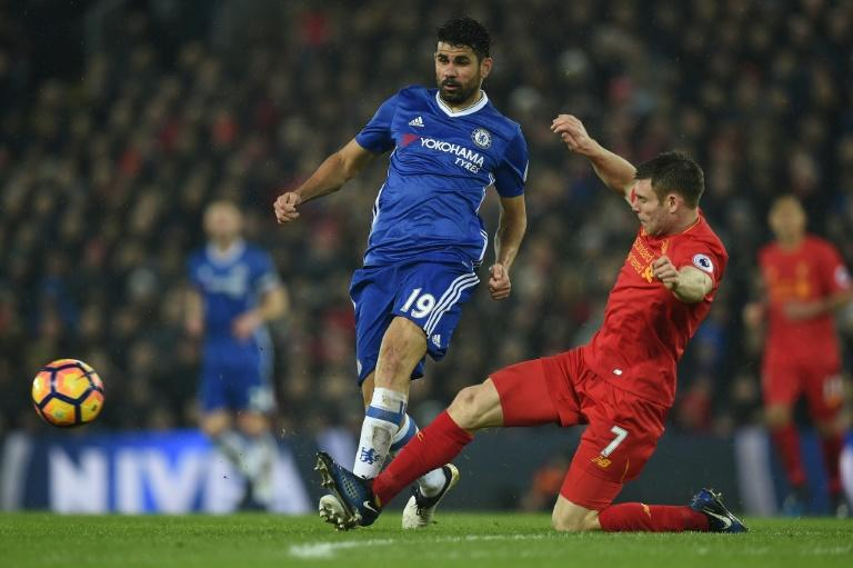 Liverpool's midfielder James Milner (R) vies with Chelsea's striker Diego Costa during the English Premier League football match January 31, 2017