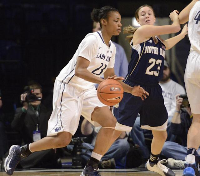 Penn State forward Ariel Edwards, left, tries to get past Notre Dame guard Michaela Mabrey in the second half of an NCAA college basketball game on Wednesday, Dec. 4, 2013, in State College, Pa. Notre Dame defeated Penn State 77-67. (AP Photo/John Beale)