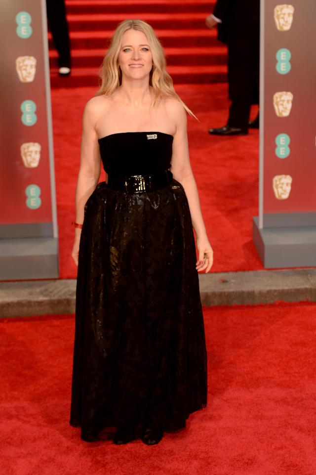 <p>The radio announcer braved the cold in a strapless gown. <em>[Photo: Getty]</em> </p>