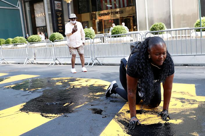 <p>Bevelyn Beatty defacing the BLM mural outside Trump Tower on 18 July</p>REUTERS