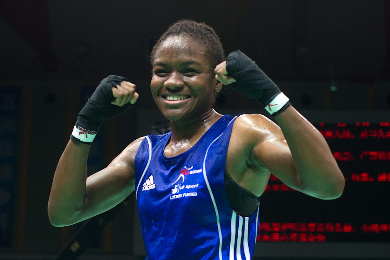 Nicola Adams of England gestures following her win against Elena Savelyeva of Russia during their flyweight semi-final bout at the Women's World Boxing Championships in Qinhuangdao on May 18, 2012.  Eight places in the three Olympic weight categories, flyweight, lightweight and middleweight, are up for grabs at the world championships, with another four awarded to small and developing countries. Adams won 11-6.   AFP PHOTO / Ed JonesEd Jones/AFP/GettyImages