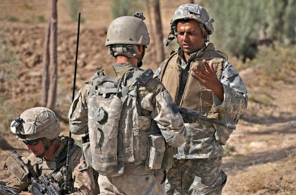 PHOTO: Translator Mohammed Shakir, of Afghanistan, translates for U.S. forces, during a U.S. Marine patrol in an area frequented by Taliban militants, in Nawa district, Helmand province, Afghanistan, Sept. 28, 2009. (Brennan Linsley/AP, FILE)