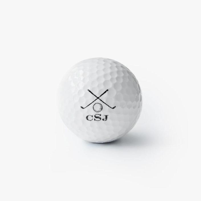 """$59, MARK AND GRAHAM. <a href=""""https://www.markandgraham.com/products/personalized-golf-ball-set"""" rel=""""nofollow noopener"""" target=""""_blank"""" data-ylk=""""slk:Buy Now"""" class=""""link rapid-noclick-resp"""">Buy Now</a><br>"""