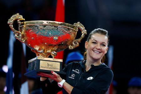 FILE PHOTO: Tennis - China Open women's final - Beijing, China - 09/10/16. Poland's Agnieszka Radwanska holds the trophy after defeating Britain's Johanna Konta. REUTERS/Thomas Peter/File Photo