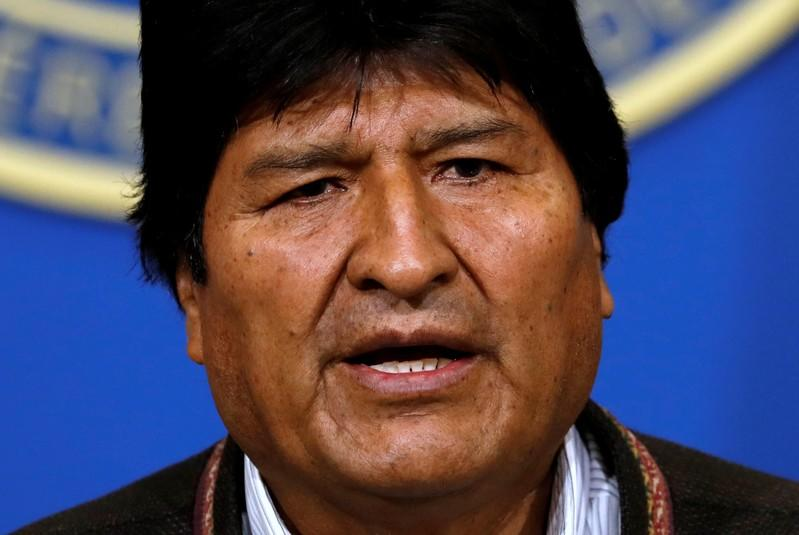 Bolivia's President Evo Morales addresses the media at the presidential hangar in the Bolivian Air Force terminal in El Alto