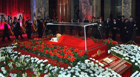 FILE PHOTO - The body of North Korean leader Kim Jong-il lies in state at the Kumsusan Memorial Palace in Pyongyang in this picture released by the North's official KCNA news agency early December 21, 2011. KCNA via REUTERS/File Photo