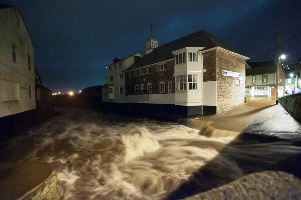 Flooding hit the town of Newlyn, Cornwall, on Saturday night (SWNS)