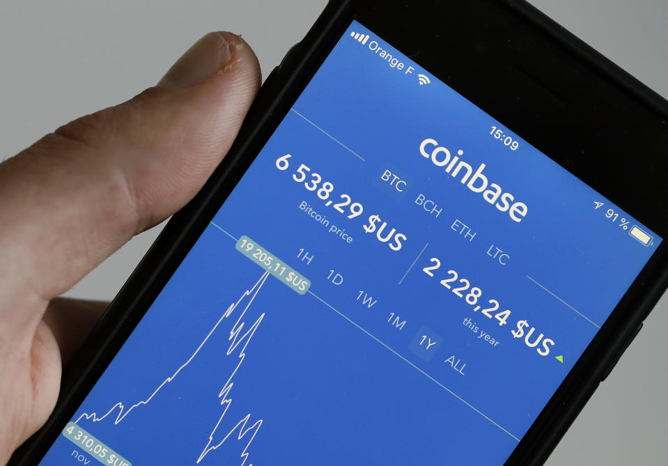 The Coinbase cryptocurrency exchange application is seen on the screen of an iPhone on October 05, 2018 in Paris, France. (Photo Illustration by Chesnot/Getty Images)