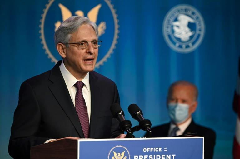 Judge Merrick Garland (L) has been nominated by US President-elect Joe Biden (R) to be attorney general