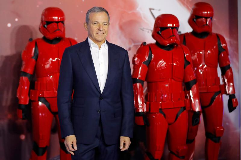 Disney CEO Bob Iger poses on the red carpet with sith stormtroopers upon arrival for the European film premiere of Star Wars: The Rise of Skywalker in London on December 18, 2019. (Photo by Tolga AKMEN / AFP) (Photo by TOLGA AKMEN/AFP via Getty Images)