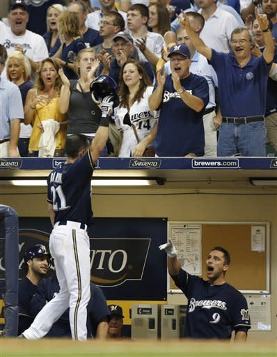 CORRECTS PLAYER'S FIRST NAME - Milwaukee Brewers' Cody Ransom (21) reacts after his grand slam home run against the Pittsburgh Pirates during the eighth inning of a baseball game, Friday, July 13, 2012, in Milwaukee. (AP Photo/Jeffrey Phelps)