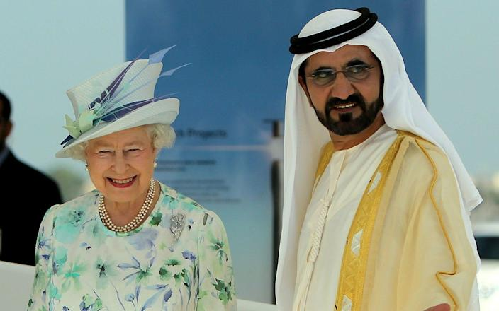 Queen Elizabeth II is escorted by Sheikh Mohammed bin Rashed al-Maktoum, Emirati vice president and ruler of Dubai - MARWAN NAAMANI /AFP