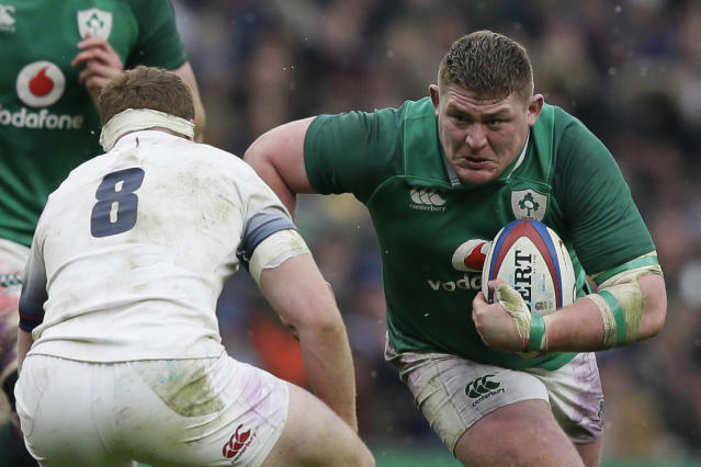 Ireland's Tadhg Furlong, right, runs through the English defense, Sam Simmonds, during the Six Nations rugby union match between England and Ireland at Twickenham stadium in London, Saturday, March 17, 2018. (AP Photo/Tim Ireland)