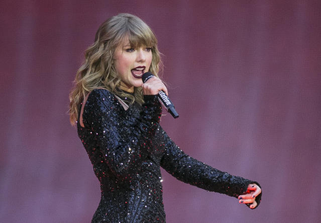 FILE - In this June 22, 2018, file photo, singer Taylor Swift performs on stage in concert at Wembley Stadium in London. A 27-year-old Austin, Texas, man has pleaded guilty to stalking and sending threatening letters and emails to pop star Taylor Swift's former record label. Federal prosecutors in Nashville, Tennessee, said in a news release the letters to Big Machine Label Group began in January 2018 with Eric Swarbrick asking the CEO to introduce him to Swift. (Photo by Joel C Ryan/Invision/AP, File)